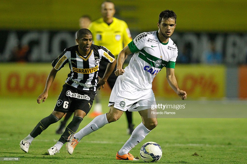 Junior Cesar of Botafogo strugles for the ball with Norberto of Coritiba during the match between Botafogo and Coritiba for the Brazilian Series A 2014 at Raulino de Oliveira Stadium on July 19, 2014 in Volta Redonda, Brazil.