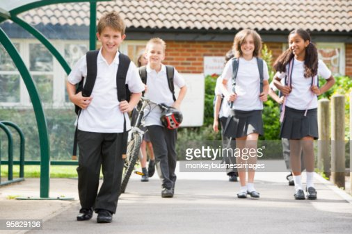 Junior children leaving school : Stock Photo