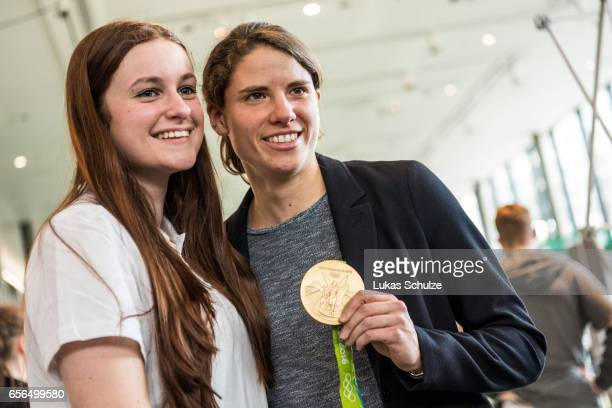 Junior Coach poses with soccer player Annike Krahn during the tribute to the DFB Junior Coaches in the Deutsches Fussballmuseum on March 22 2017 in...