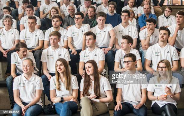 Junior Coaches listen to the presentation of former soccer coach Horst Hrubesch and soccer player Annike Krahn during the tribute to the DFB Junior...