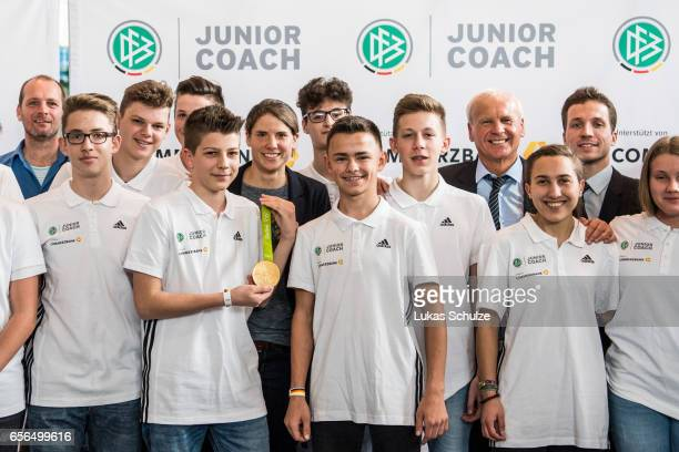 Junior Coaches pose with soccer player Annike Krahn during the tribute to the DFB Junior Coaches in the Deutsches Fussballmuseum on March 22 2017 in...