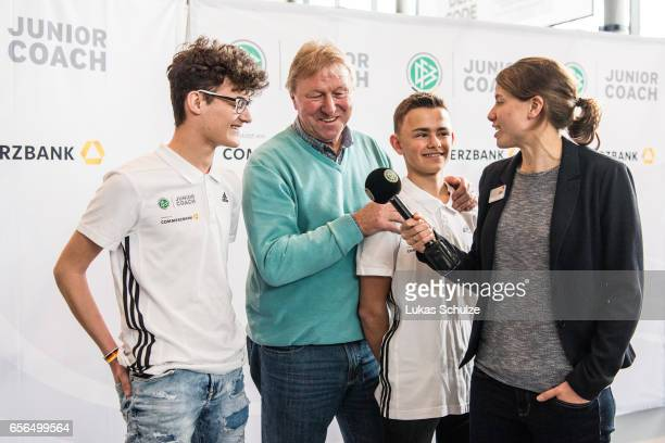 Junior Coaches talk to former soccer coach Horst Hrubesch and soccer player Annike Krahn during the tribute to the DFB Junior Coaches in the...