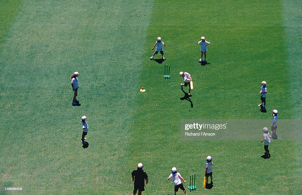 Junior cricketors playing on Melbourne Cricket Ground during Boxing Day test match interval. : Stock Photo