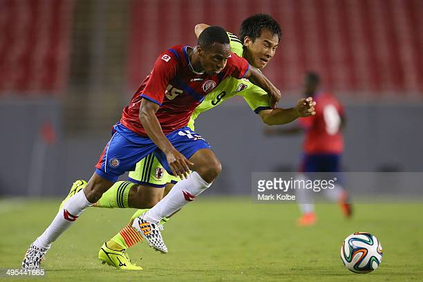Junior Diaz of Costa Rica and Shinji Okazaki of Japan compete for the ball during the International Friendly Match between Japan and Costa Rica at...
