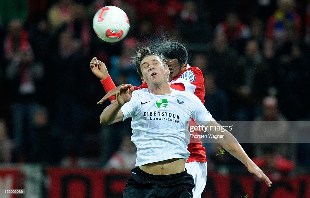 Junior Diaz (R) of Mainz battles for the ball with Jakub Sylvestre (L) of Aue during the DFB Cup second round match between FSV Mainz 05 and FC Erzgebirge Aue at Coface Arena on October 30, 2012 in Mainz, Germany.