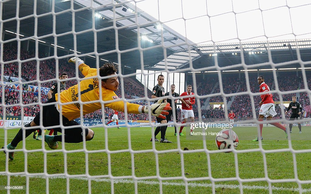 Junior Diaz of Mainz scores his team's first goal past goalkeeper Roman Buerki of Freiburg during the Bundesliga match between FSV Mainz 05 and SC Freiburg at Coface Arena on November 22, 2014 in Mainz, Germany.