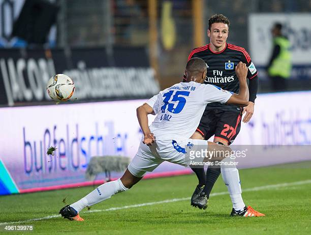 Junior Diaz of SV Darmstadt 98 challenges Nicolai Mueller of Hamburger SV during the first bundesliga match between SV Darmstadt 98 and Hamburger SV...