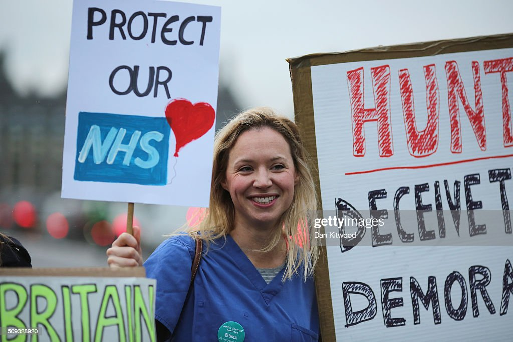 Junior Doctors carry a placards on Westminster Bridge as they demonstrate outside St Thomas's Hospital on February 6, 2016, in London, England. Junior Doctors across the United Kingdom began a 24 hour strike today over the British governments' plans to change contracts for junior doctors. Doctors have claimed that Prime Minister David Cameron's government is not providing enough resources for the state-run National Health Service (NHS), which was founded by a socialist government in 1948 to provide free health care at the point of delivery.