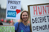 Junior Doctors carry a placards on Westminster Bridge as they demonstrate outside St Thomas's Hospital on February 10 in London England Junior...