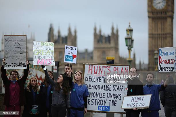 Junior Doctors carry placards on Westminster Bridge as they demonstrate outside St Thomas's Hospital on February 10 in London England Junior Doctors...
