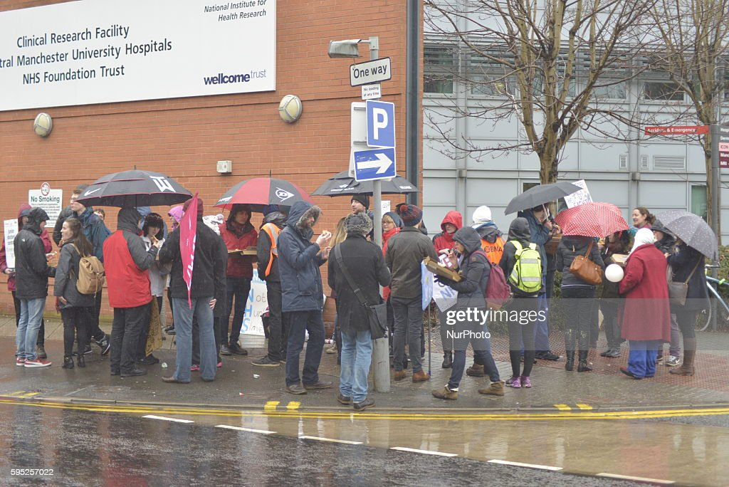 Junior doctors striking over the issue of weekend pay outside Manchester Royal Infirmary where they are holding a picket line in Manchester Greater...