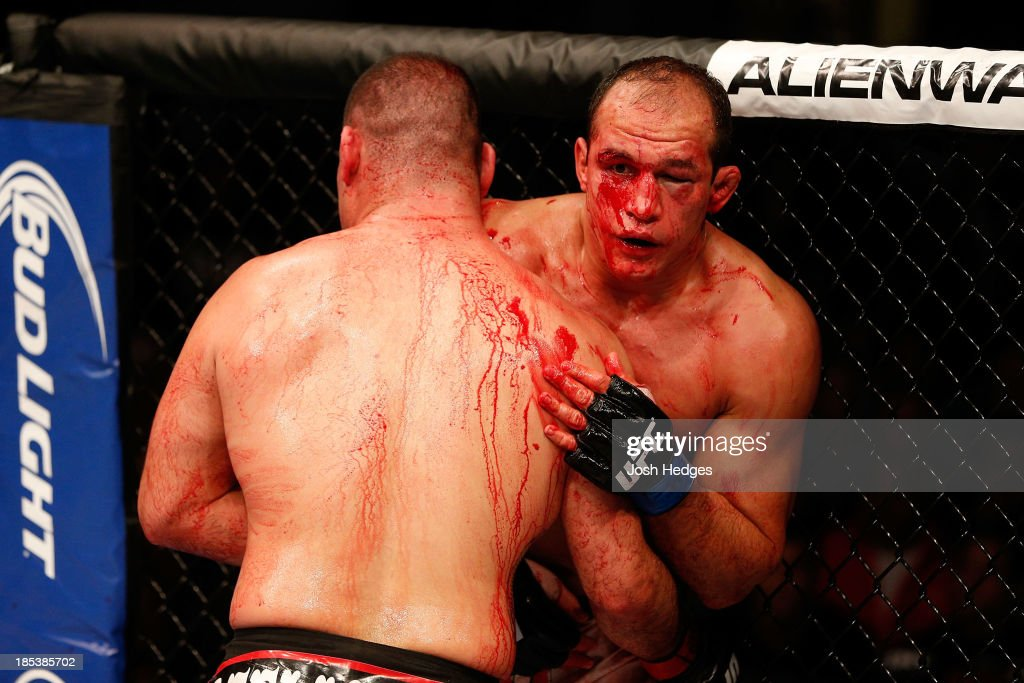 Junior Dos Santos leans on Cain Velasquez in their UFC heavyweight championship bout at the Toyota Center on October 19, 2013 in Houston, Texas. Cain Velasquez defeated Junior Dos Santos by TKO.