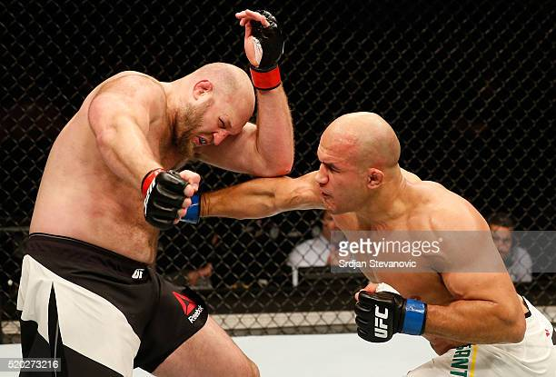 Junior Dos Santos punches Ben Rothwell in their heavyweight bout during the UFC Fight Night event at the Arena Zagreb on April 10 2016 in Zagreb...