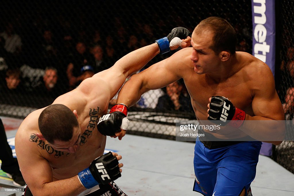 Junior dos Santos punches <a gi-track='captionPersonalityLinkClicked' href=/galleries/search?phrase=Cain+Velasquez&family=editorial&specificpeople=5445619 ng-click='$event.stopPropagation()'>Cain Velasquez</a> during their heavyweight championship fight at UFC 155 on December 29, 2012 at MGM Grand Garden Arena in Las Vegas, Nevada.