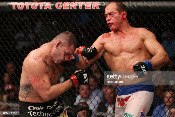 Junior Dos Santos punches Cain Velasquez in their UFC heavyweight championship bout at the Toyota Center on October 19 2013 in Houston Texas