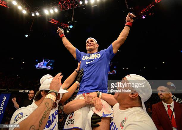 Junior dos Santos reacts to his victory over Mark Hunt in their heavyweight bout during UFC 160 at the MGM Grand Garden Arena on May 25 2013 in Las...