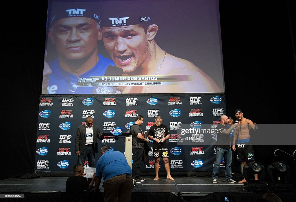 Junior Dos Santos (R) talks with Joe Rogan (2R) on stage during the UFC 166 weigh-in at the Toyota Center on October 18, 2013 in Houston, Texas.