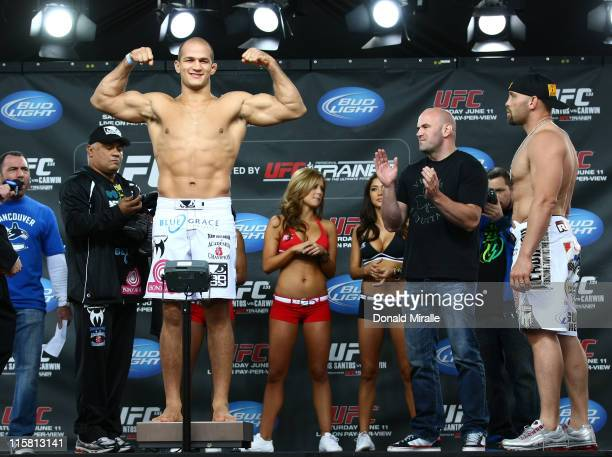 Junior Dos Santos weighs in as opponent Shane Carwin looks on at the UFC 131 weighin at Jack Poole Plaza on June 10 2011 in Vancouver British...