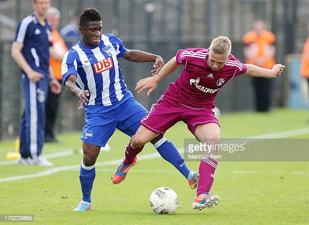 Junior Ebot Etchi of Berlin battles for the ball with Daniel Koseler of Schalke during the B Juniors Bundesliga semi final match between Hertha BSC...