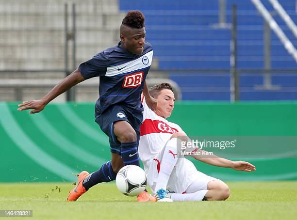 Junior Ebot Etchi of Berlin battles for the ball with Marvin Bueyueksakarya of Stuttgart during the B Juniors Bundesliga final match between Hertha...