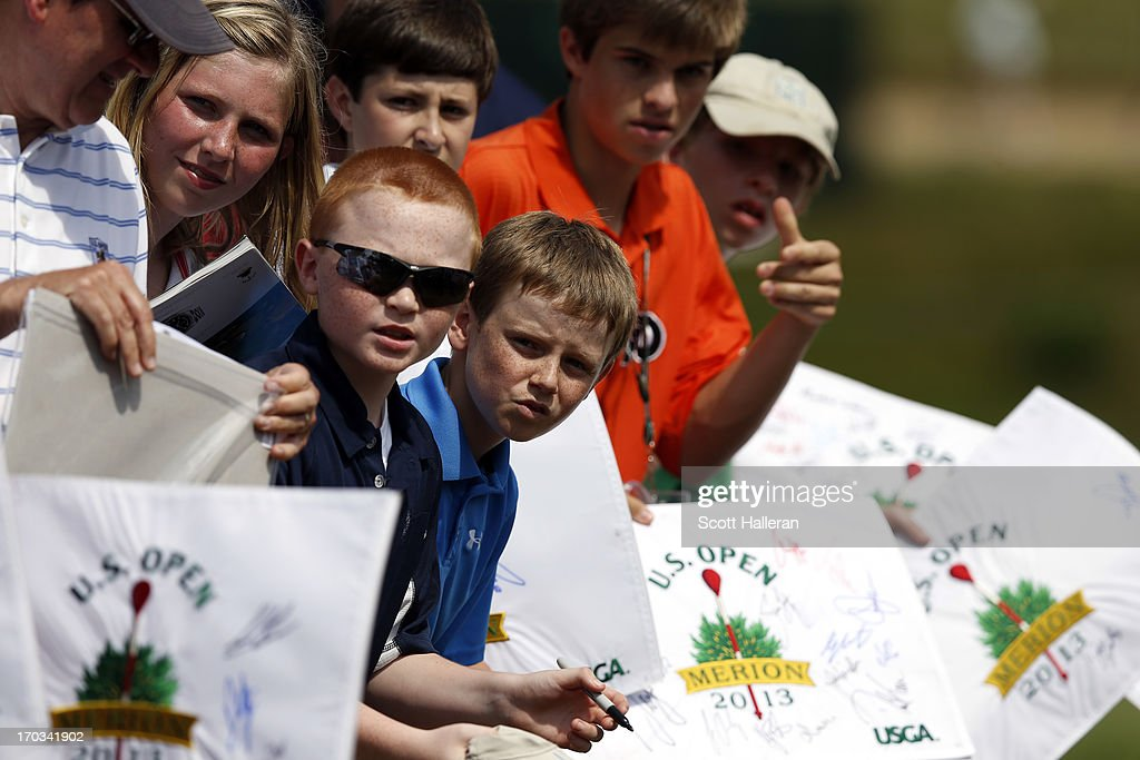 Junior fans wait for autographs during a practice round prior to the start of the 113th U.S. Open at Merion Golf Club on June 11, 2013 in Ardmore, Pennsylvania.