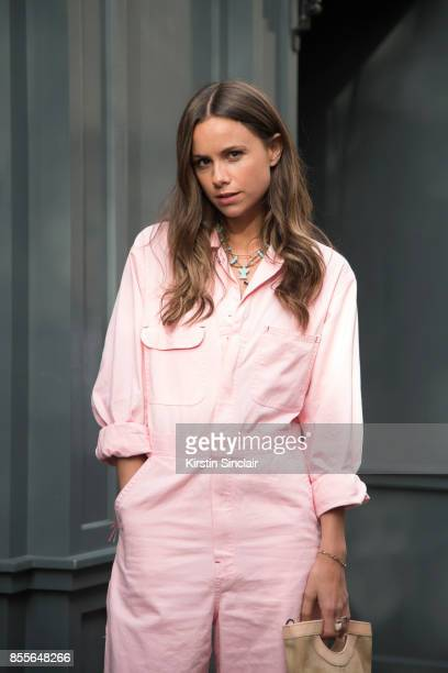 Junior fashion editor at Harpers Bazaar Uk and Town and country Florrie Thomas wearing an Asos jumpsuit and a Max V Koenig bag on day 2 of London...