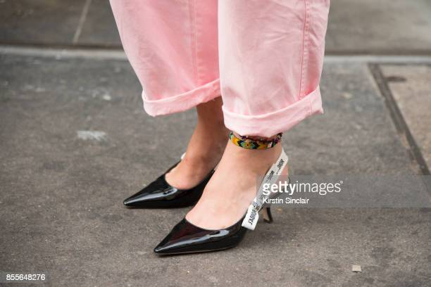 Junior fashion editor at Harpers Bazaar Uk and Town and country Florrie Thomas wearing an Asos jumpsuit Dior shoes on day 2 of London Womens Fashion...