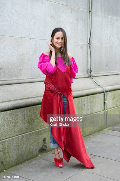 Junior fashion editor at Harpers Bazaar UK Anna Vitiello wears a Rejina Pyo top DKNY dress vintage jeans and Malone Souliers shoes on day 4 of London...