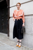 Junior Fashion Editor Marianna Frannais wears a vintage top and shoes Cos trousers and Zara bag on day 1 of London Collections Men on June 15 2014 in...