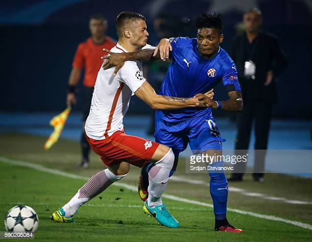 Junior Fernandes of Dinamo Zagreb iis challenged by Duje CaletaCar of Salzburg during the UEFA Champions League Playoffs First leg match between...