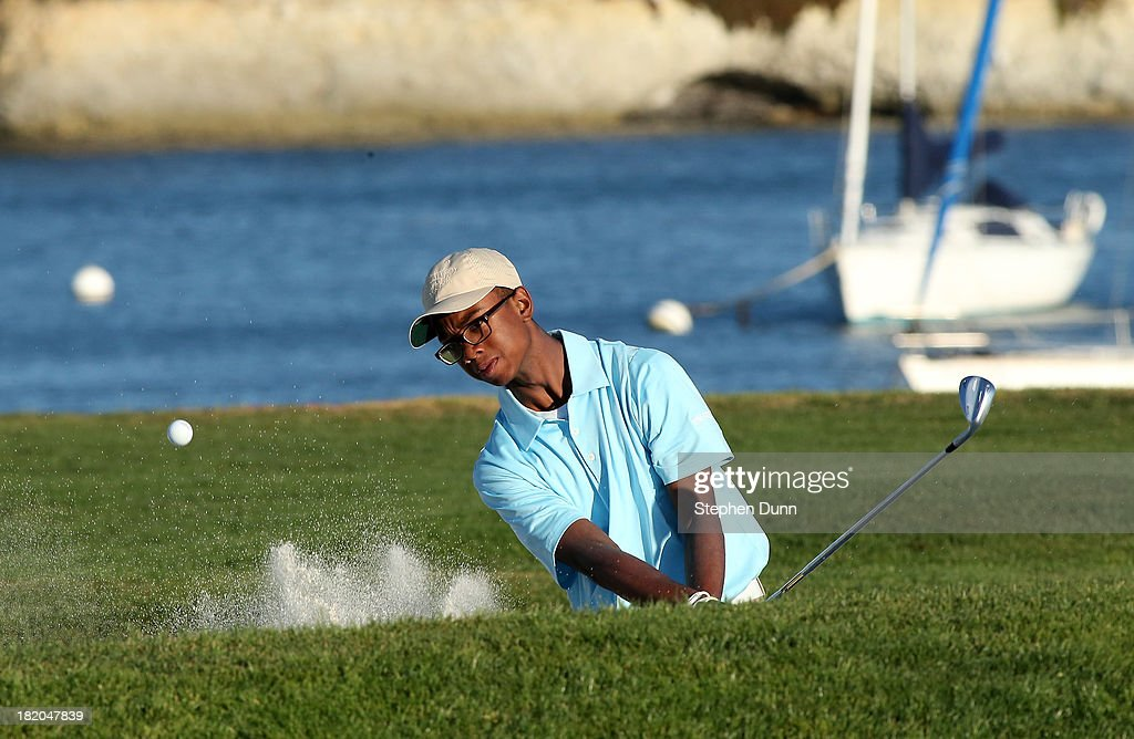 Junior First Tee player Carey Ray hits out of a bunker on the 17th hole durng the first round of the Nature Valley First Tee Open at Pebble Beach at...