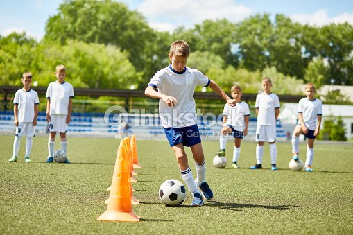 Junior Football Player at Practice : Stock Photo