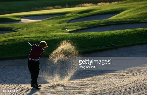 Junior Golfer Hitting Bunker Shot