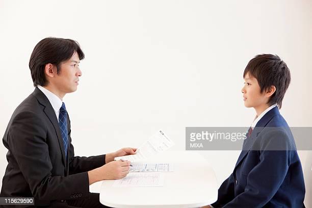 Junior High School Boy and Teacher Having a Meeting