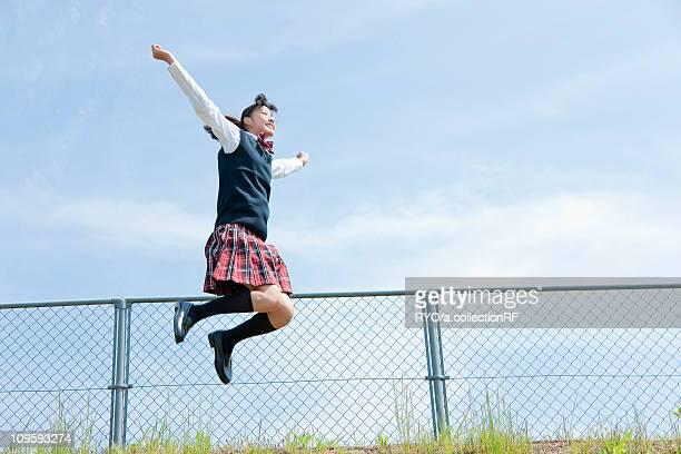 Junior High School Student Jumping of Joy