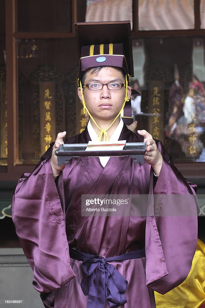 A junior high school student performs at an event to commemorate the 2563rd birthday of China's most revered sage Confucius at the Taipei Confucius Temple. Confucius Birthday is also known in Taiwan and in the Chinese speaking world as Teacher's day..