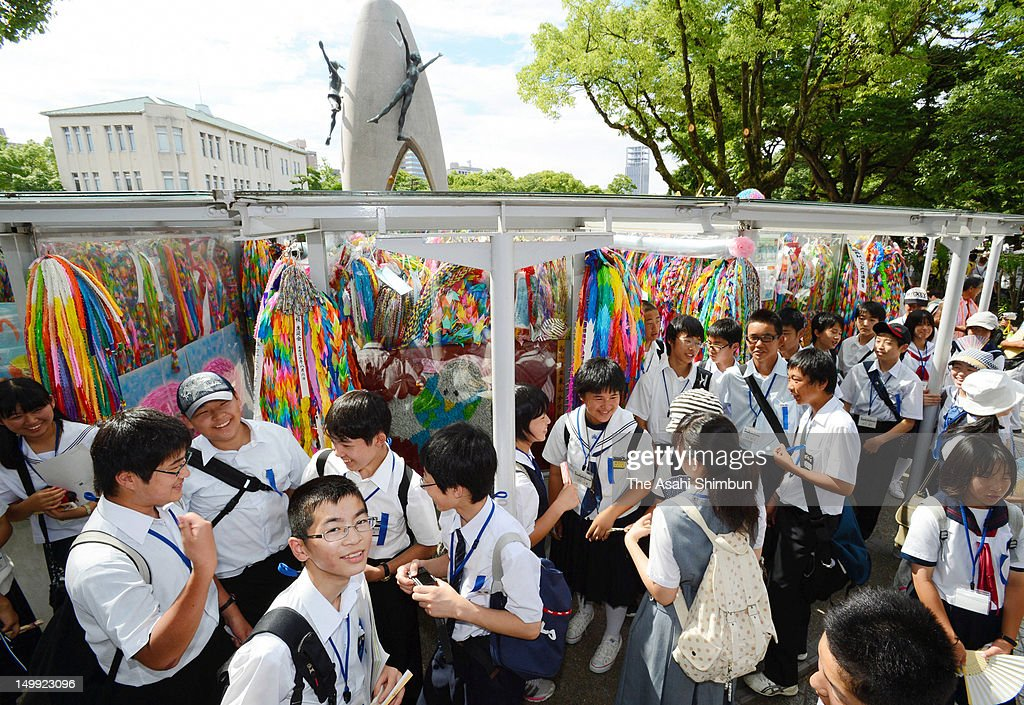 Junior high school students from Fukushima prefecture visit the Children's Peace Monument, or 'Genbaku no Ko no Zo' is seen at the Hiroshima Peace Memorial Park in the morning of August 6, 2012 in Hiroshima, Japan. Hiroshima marks the 67th anniversary of its atomic bombing under the shadow of the Fukushima nuclear disaster and by issuing a plea for complete nuclear disarmament.