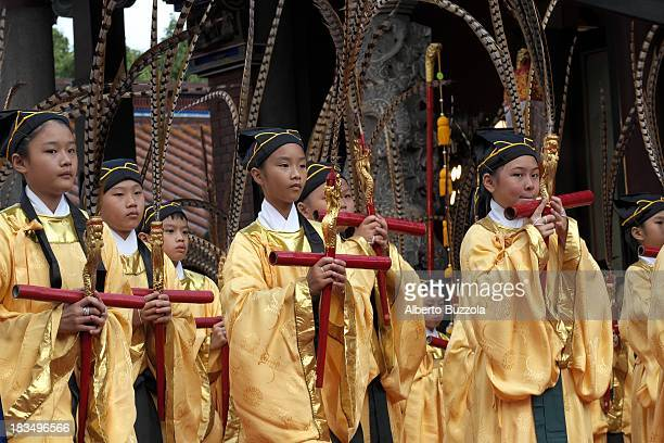 Junior High School students performing a traditional dance to commemorate the 2563rd birthday of China's most revered sage Confucius at the Taipei...