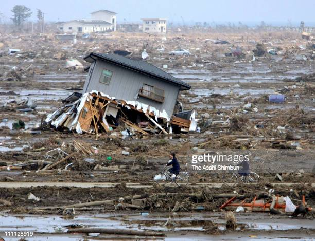 Junior high school students return home amongst rubble on March 30 2011 in Yamamoto Miyagi Japan More than three weeks after the magnitude 9...