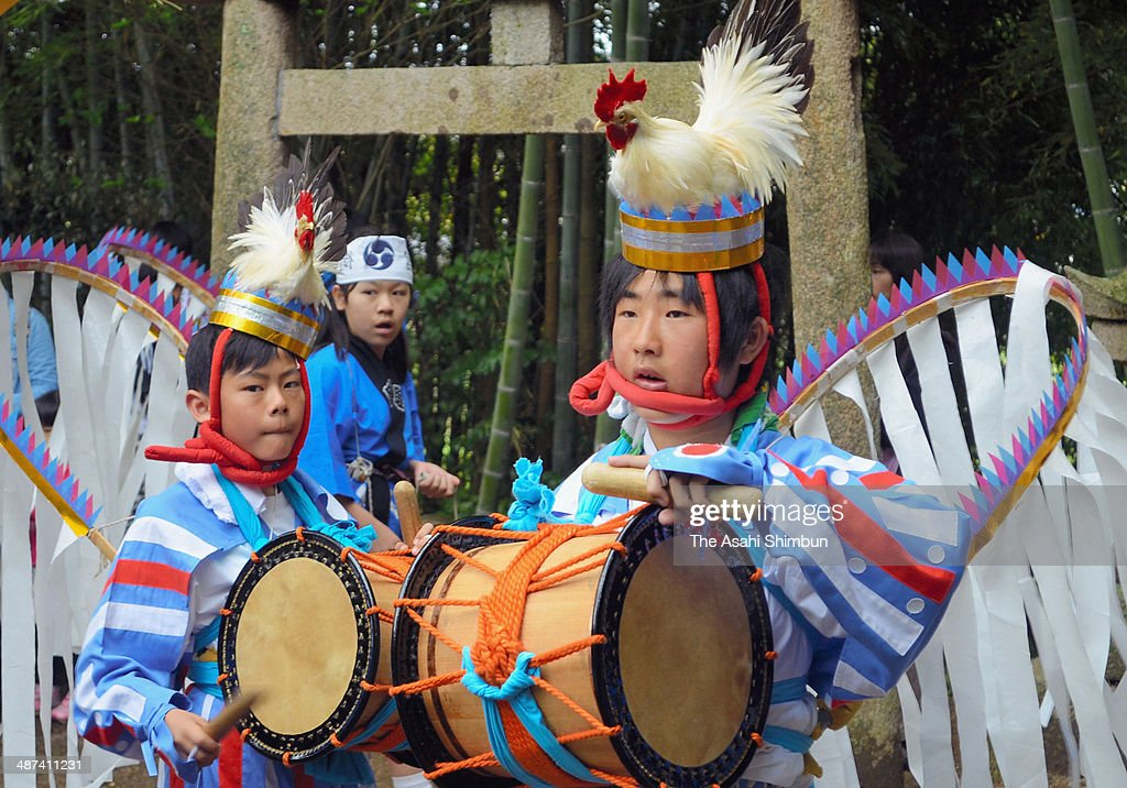 Junior high school students wearing stuffed cock on their heads performs Tokei (cockfighting) Dance at a shrine on April 29, 2014 in Yamaguchi, Japan. The dance is dedicated to the shrine in pray for livestock security.