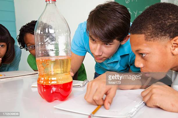 Junior High students in science class watching simulated lava lamp