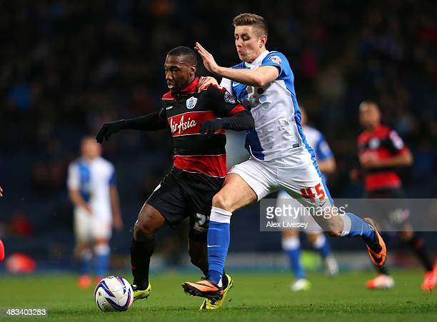 Junior Hoilett of Queens Park Rangers holds off a challenge from Tom Cairney of Blackburn Rovers during the Sky Bet Championship match between...