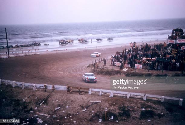 Junior Johnson in the Pontiac car races around the beach during the Daytona Beach and Road Course on February 26 1956 in Daytona Beach Florida