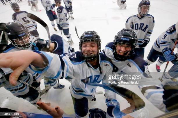 Junior Joseph Graziano center left and sophomore Jacob Nelson centerright join with York teammates and classmates at the glass to celebrate an...