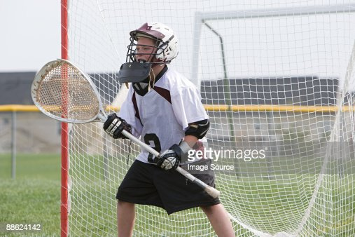 Junior lacrosse player in goal