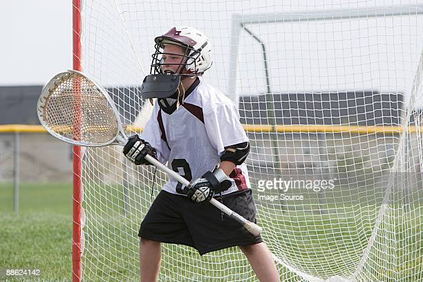 Junior lacrosse player in goal
