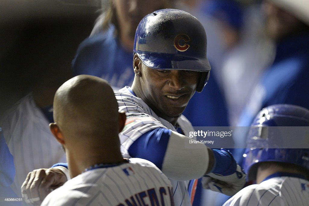 Junior Lake #21 of the Chicago Cubs (R) and teammate <a gi-track='captionPersonalityLinkClicked' href=/galleries/search?phrase=Emilio+Bonifacio&family=editorial&specificpeople=4193706 ng-click='$event.stopPropagation()'>Emilio Bonifacio</a> #64 celebrate in the dugout after Lake hit a solo home run during the fifth inning against the Pittsburgh Pirates at Wrigley Field on April 9, 2014 in Chicago, Illinois.
