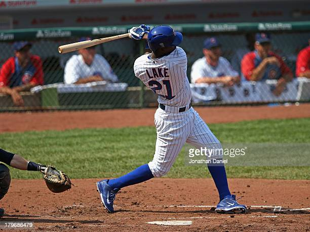 Junior Lake of the Chicago Cubs hits a grand slam home run in the 1st inning against the Milwaukee Brewers at Wrigley Field on September 6 2013 in...