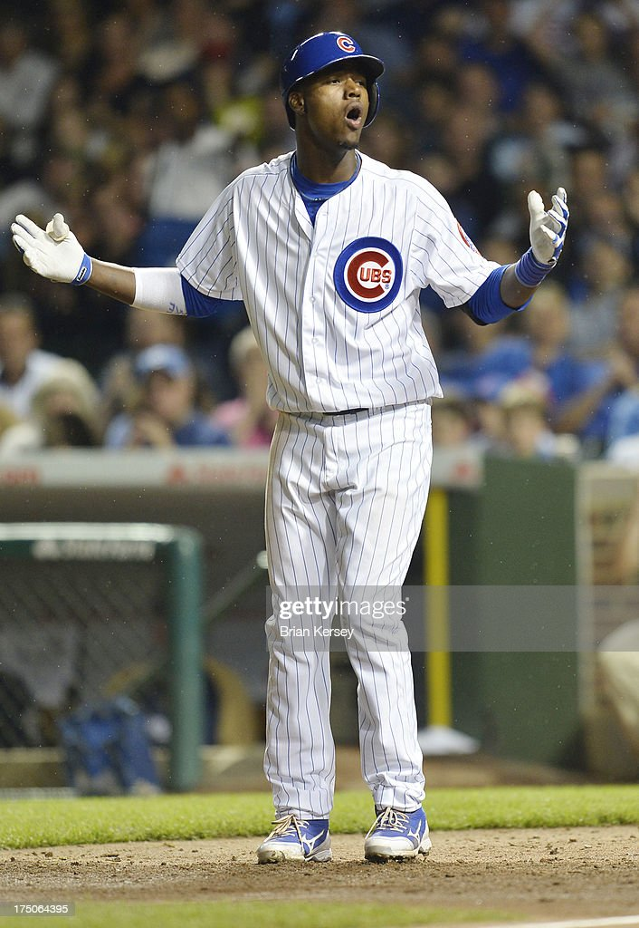 Junior Lake #21 of the Chicago Cubs reacts after a called strike three during the fifth inning of game two of a double header against the Milwaukee Brewers at Wrigley Field on July 30, 2013 in Chicago, Illinois.