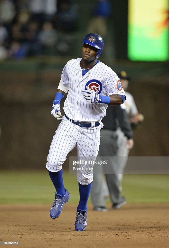 Junior Lake #21 of the Chicago Cubs rounds the bases after hitting a solo home run during the fifth inning against the Pittsburgh Pirates at Wrigley Field on April 9, 2014 in Chicago, Illinois.